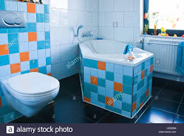 white bathroom black floor colorful decorated with tiles in