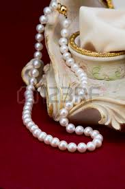 pearl necklace jewelry box images Pearl necklace beside the ceramic jewelry box on red background jpg