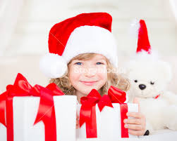 xmas gift happy child holding christmas gift funny baby dressed in santa
