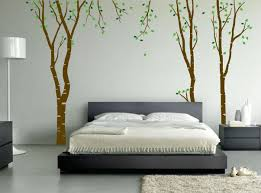 wide platform bed and white bedding beside tree mural on grey wall ideas wide platform bed and white bedding beside tree mural on grey wall painting ideas inside