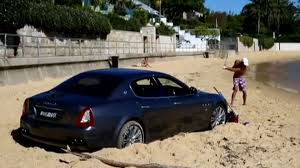 maserati bentley australian man drives maserati quattroporte onto beach