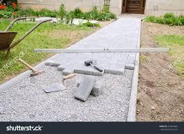 paver stones for patios bricklayer places concrete paving stone blocks stock photo