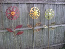 yard art ideas from junk yard stake wild flower metal