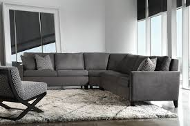 calming dark grey l shaped extra long couch on moroccan rug of