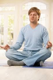 Livingroom Yoga Man Sitting On Living Room Floor In Lotus Posture Doing Yoga
