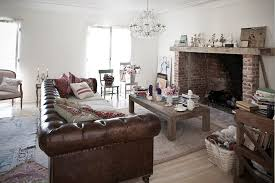 country chic living room large leather chesterfield sofa sits at the heart of shabby chic