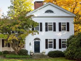 traditional white colonial house entrance with black front door