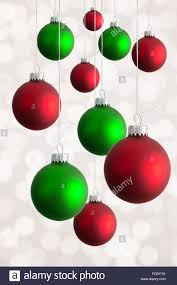 studio shot of hanging christmas baubles stock photo royalty free