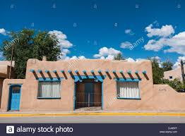 Adobe Style Home A Southwestern Adobe Style Building With Windows And Beams In The