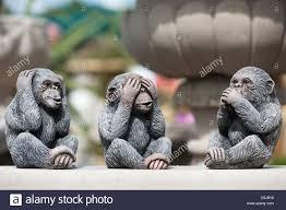 three wise monkeys garden ornaments stock photo royalty