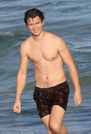 ansel elgort hits the beach in miami with high sweetheart