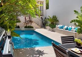awesome house facing small swimming pools and cool grass around