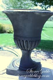 aging urn with paint stonegable