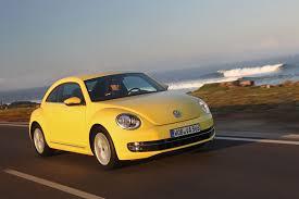 volkswagen bug yellow 2012 yellow rush volkswagen beetle front view eurocar news