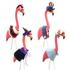 large pink flamingo lawn ornament with 4 seasonal