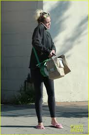 miley cyrus strips off her sweater for a visit to the nail salon