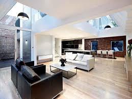 Decorating Cozy Laminate Wood Flooring With Modern Black Leather - Modern interior design styles