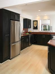 the maple hardwood flooring with the black cabinets and