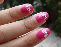 simple bow nail art tutorial with nail stamping kit peachesandblush