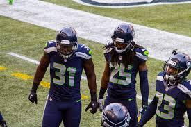 2014 thanksgiving football file kam chancellor richard sherman jeron johnson 2014 jpg