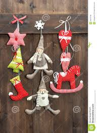 christmas decoration handmade toys on wooden background stock