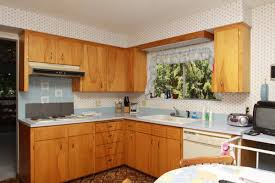 how to update kitchen cabinets without replacing them how to update 60 s flat cabinets with out replacing