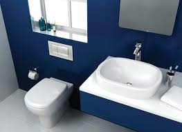dark blue bathroom decor toilet in light brown tile wall floor two