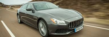 maserati quattroporte matte black behind the wheel of the maserati quattroporte s