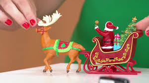 mr animated lit revolving santa sleigh tree topper on