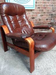 natuzzi red leather swivel chair pair of wing club and ottoman