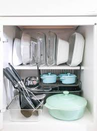 how do you arrange dishes in kitchen cabinets how to organize kitchen cabinets polished habitat