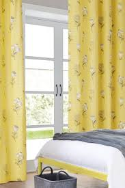 Retro Floral Curtains Buy Retro Floral Blackout Lined Eyelet Curtains From Next Kuwait