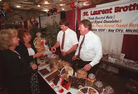 keith whitney co owner of st laurent brothers candy shop in in this 2002 photo st laurent brothers co owners steven frye left and keith whitney pass out samples of candy and nuts to mary ann badour far left