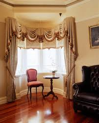top bay window treatments drapery hardware curtain rods bay window with swags and tails and matching drapes and blinds