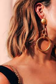 earrings all the way up the statement earring is back in a big way and we are fully