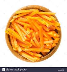 A Root Vegetable - carrot sticks in wooden bowl fresh cut crisp strips of daucus