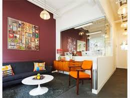 nice combination of colorful furniture and maroon wall charming