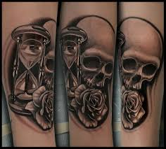 realistic banner hour glass and skull tattoos real photo