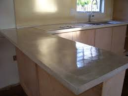 simple kitchen with beige poured concrete kitchen countertop