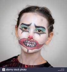 child with halloween face paint and dressed as vampire stock photo