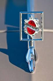 1984 oldsmobile ornament photograph by reger