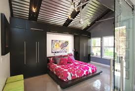 high ceiling garage remodel into moden bedroom design with red