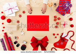 female hands tying red bow birthday stock photo 497182309