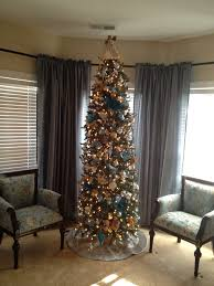 christmas tree with blue gold silver and cream ornaments