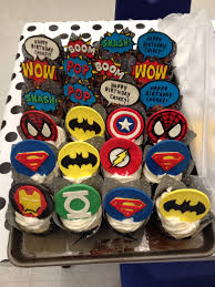 superhero cake hulk fist is rkt covered in fondant comic bubbles
