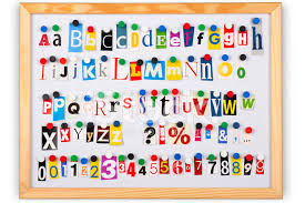 alphabet with different color cutout letters numbers and punctu