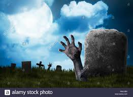 zombie hand out from the graveyard halloween concept stock photo