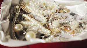 pearl necklace jewelry box images Hand takes gold necklace out of a jewelry box rings pearls and resiz