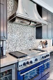 appliances mozaic tile backsplash with shiny stainless steel