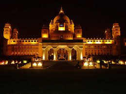 fairtytale castle lit up at night taj umaid bhawan palace hotel